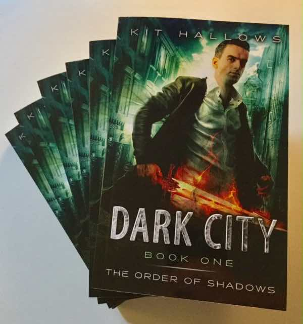 Paperback copies of the Urban Fantasy novel Dark City