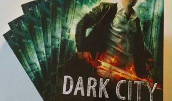 Paperback copies of the Urban Fantasy novel Dark City